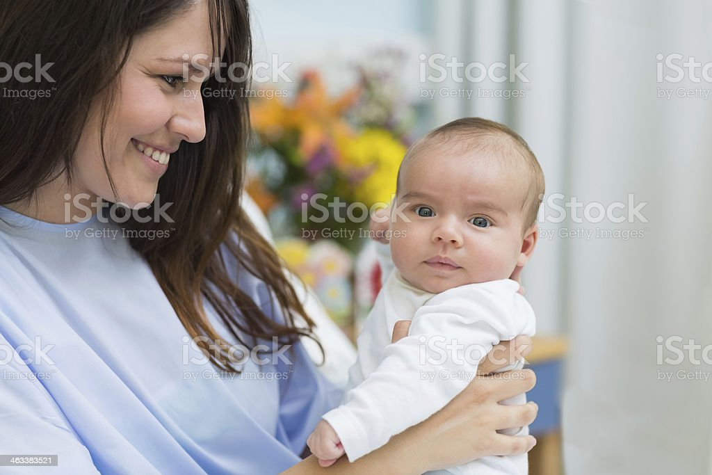 Happy mother holding a newborn baby royalty-free stock photo