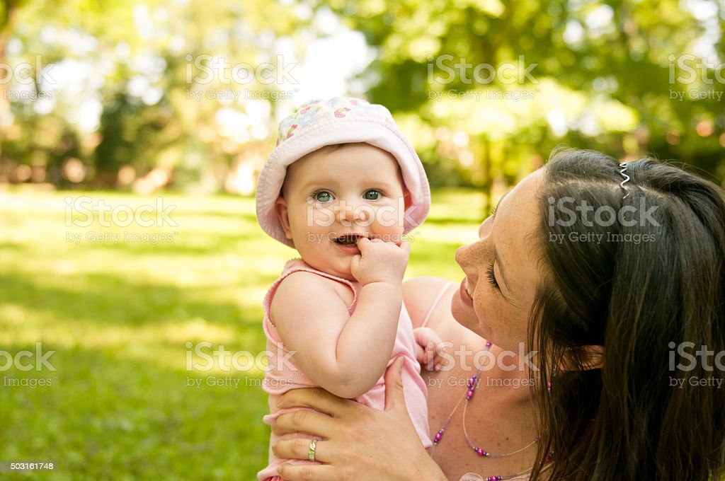 Happy mother holding her baby stock photo