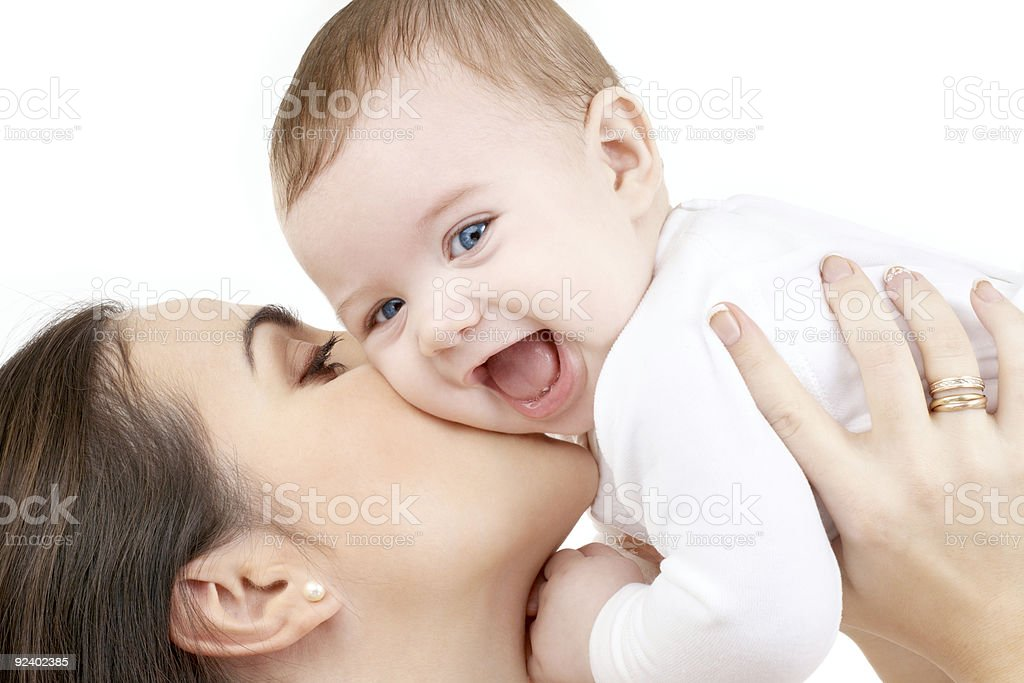 happy mother kissing her baby over white stock photo