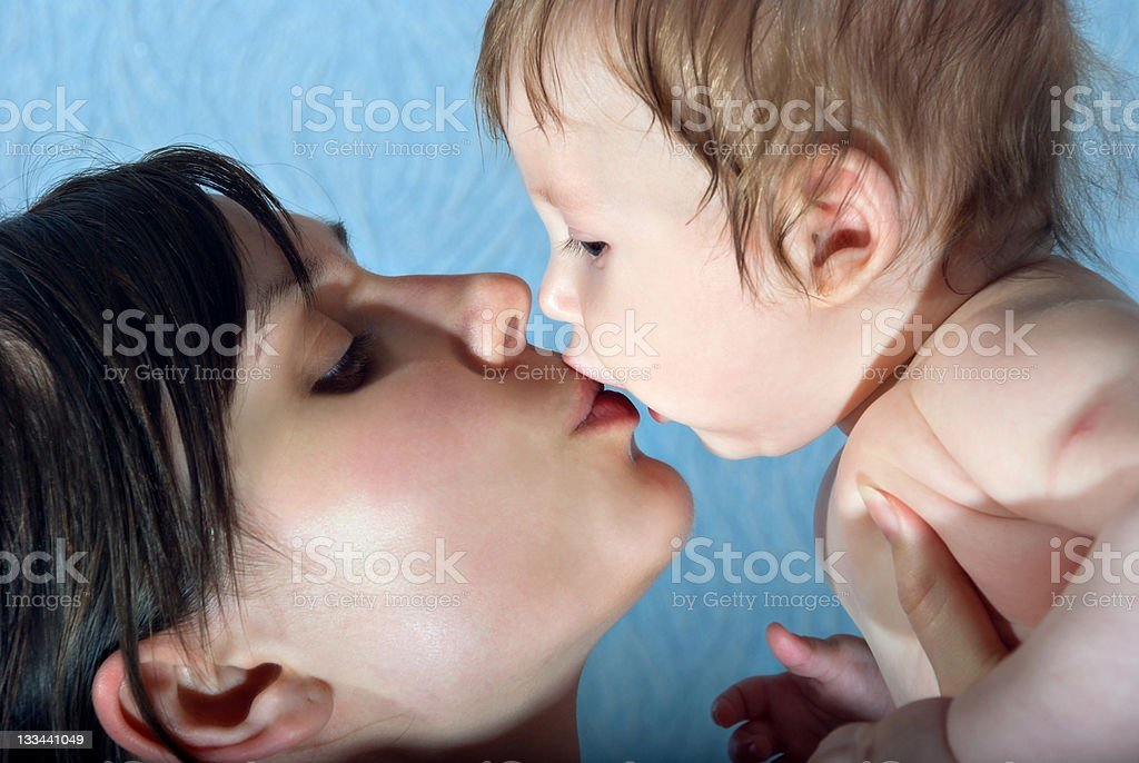 Happy mother kissing the baby royalty-free stock photo