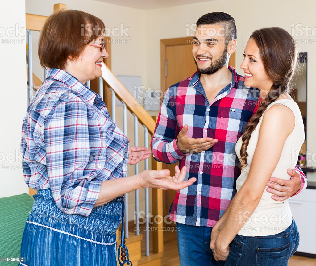 Happy mother meets girlfriend of his son stock photo
