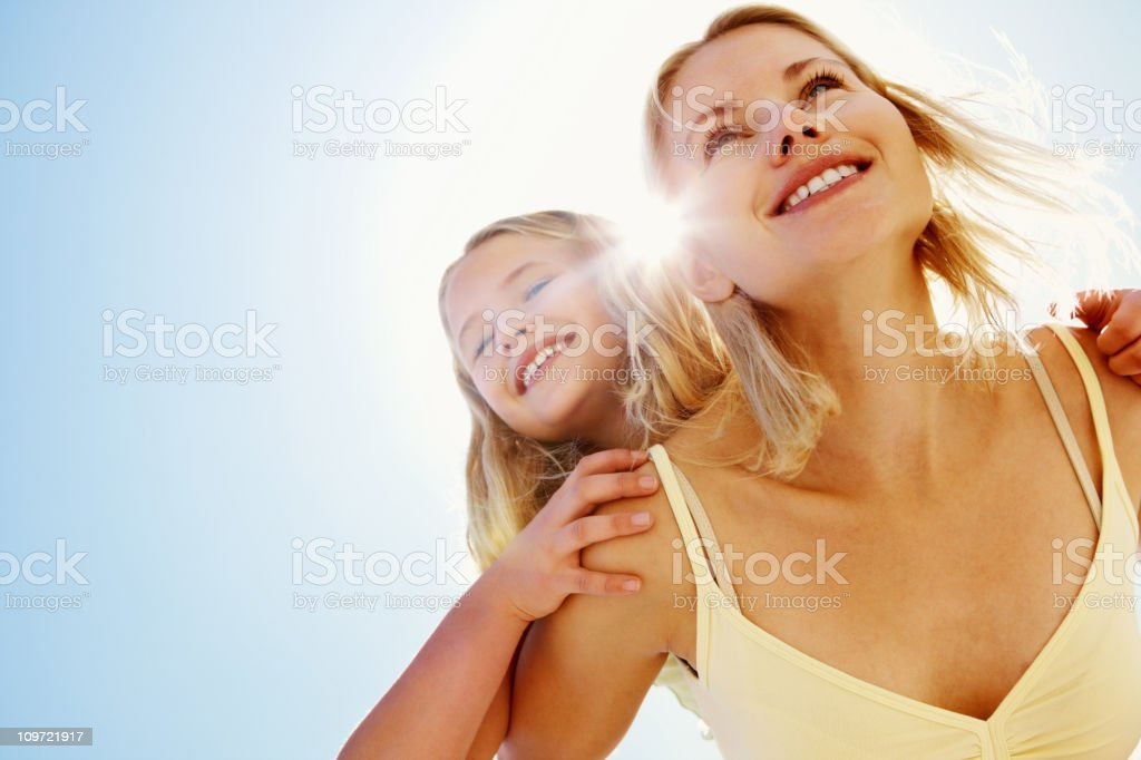 Happy mother piggybacking her daughter royalty-free stock photo