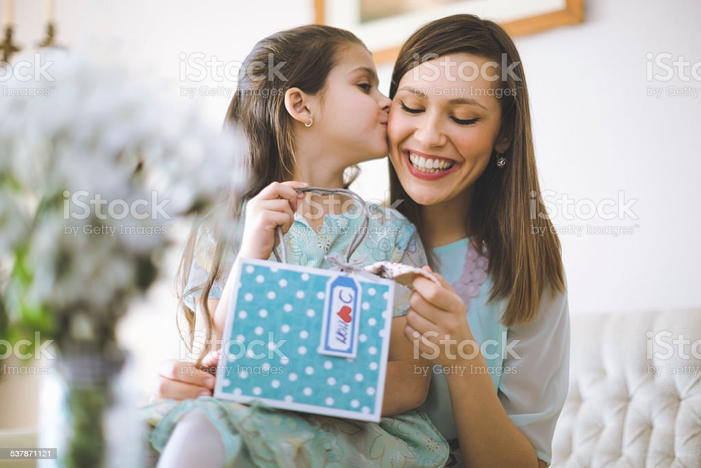 Happy mother posing with her daughter stock photo