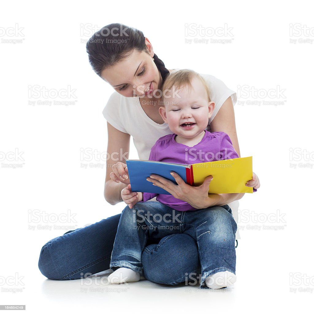 happy mother reading a book to baby girl royalty-free stock photo