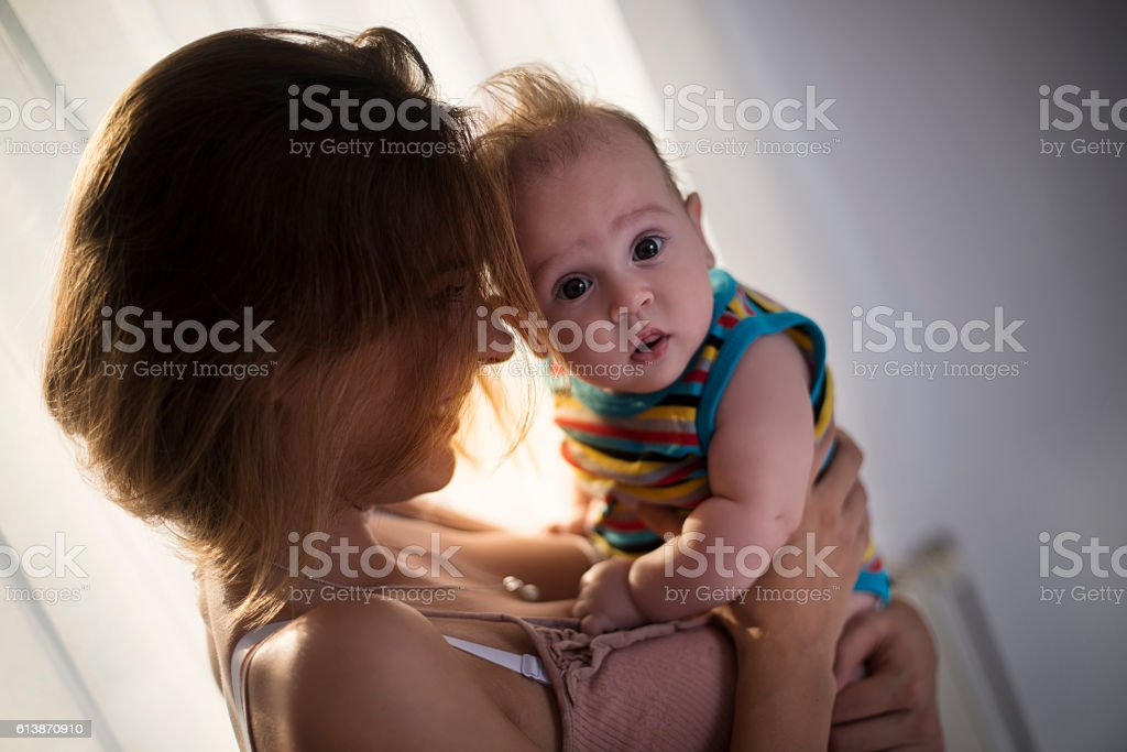 Happy mother with baby boy stock photo