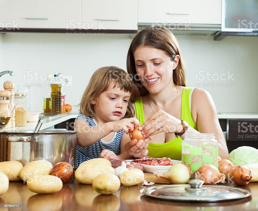 Happy mother with daughter cooking stock photo