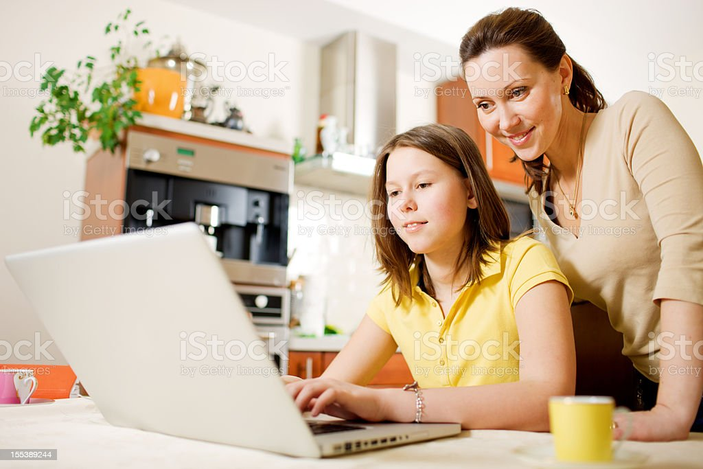 Happy Mother with Daughter using Laptop at home royalty-free stock photo