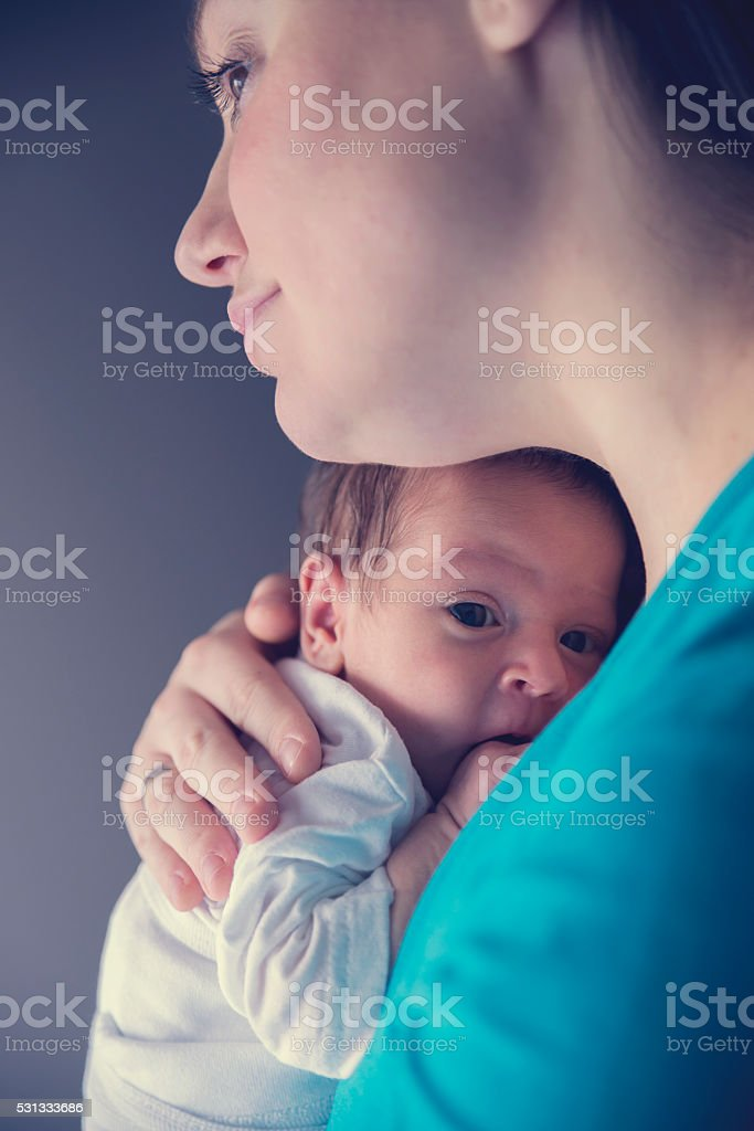 Happy mother with newborn baby boy stock photo