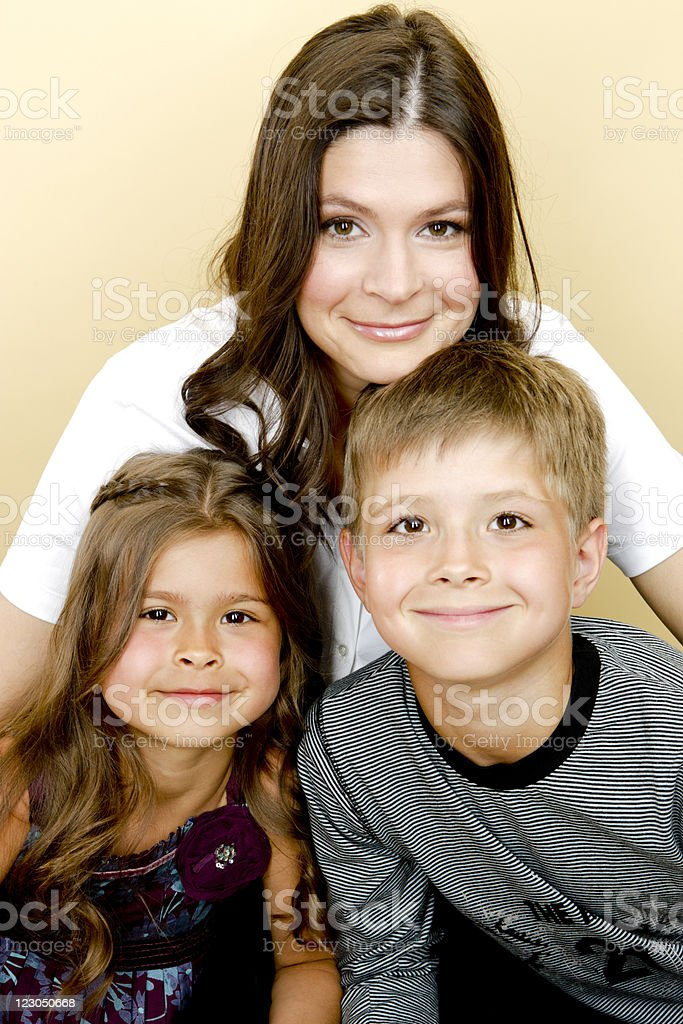 Happy mother with son and daughter stock photo