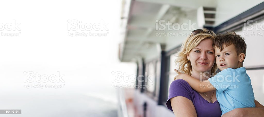 Happy mother with son on cruise ship royalty-free stock photo