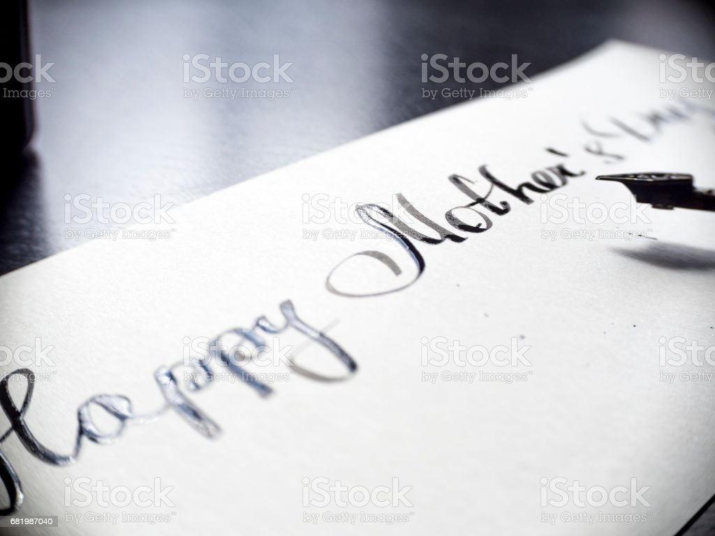 Happy Mother's day calligraphy and lattering post card. Extremely close-up stock photo