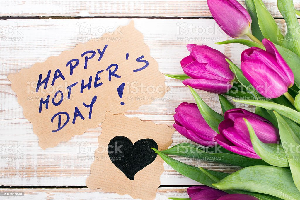 Happy Mother's Day card and a bouquet of beautiful tulips stock photo
