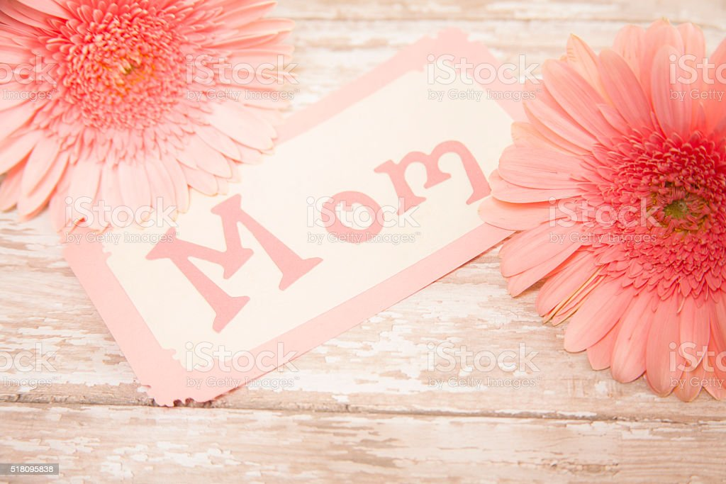 Happy Mother's Day. Flower bouquet with 'Mom' notecard. stock photo