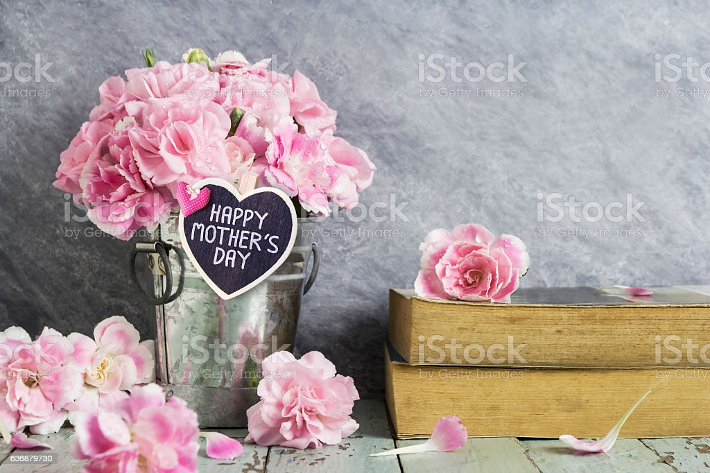 Happy mothers day letter on wood heart and pink carnation stock photo