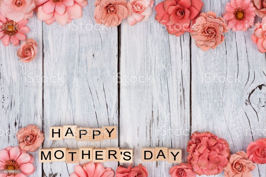 Happy Mothers Day wooden blocks with flower double border on white wood stock photo