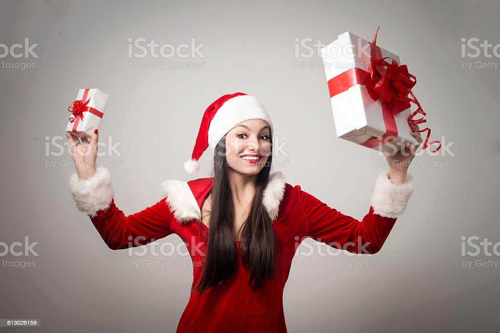 Happy Mrs. Claus with gift stock photo