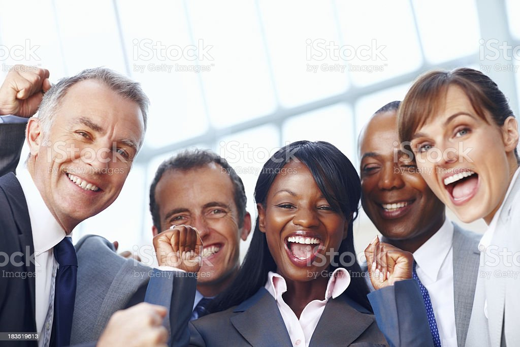 Happy multi ethnic business people enjoying success royalty-free stock photo