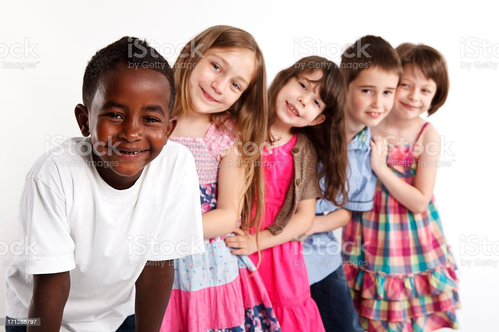 Happy multi ethnic group of children playing together royalty-free stock photo