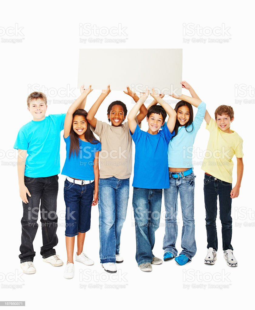 Happy multi ethnic kids holding up placard against white royalty-free stock photo