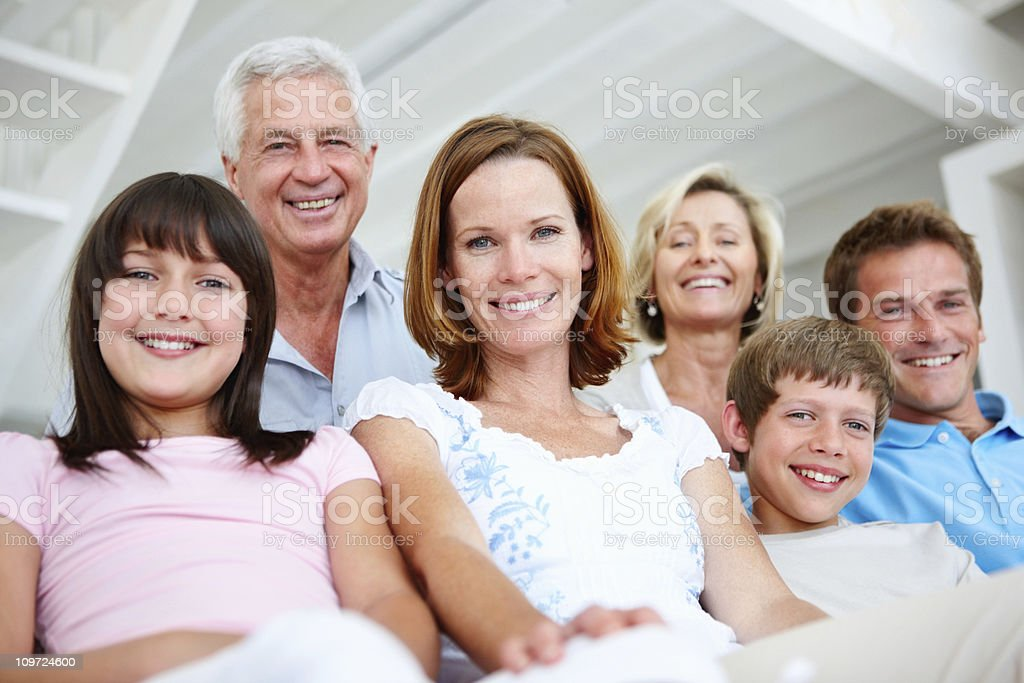 Happy multi generation family sitting together royalty-free stock photo