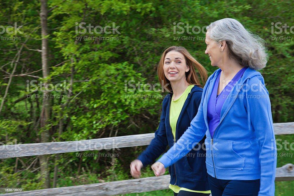 Happy Multi Generational Women Talking While Exercising Outside royalty-free stock photo