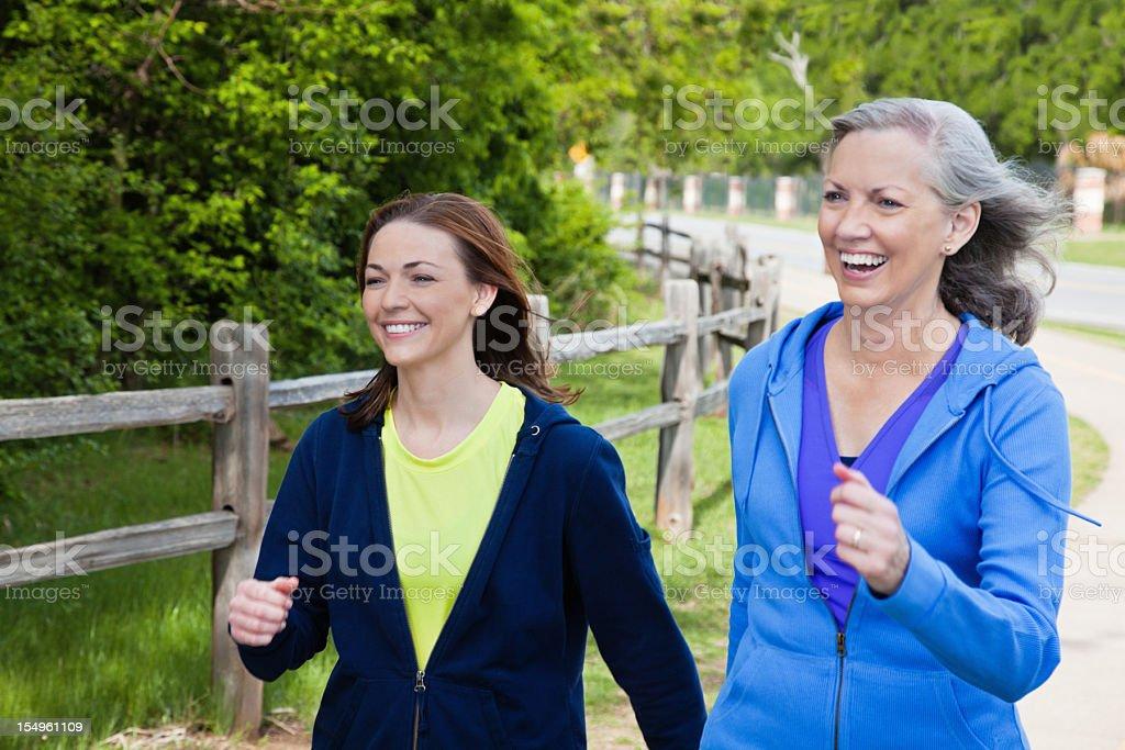 Happy Multi Generational Women Walking On a Trail royalty-free stock photo