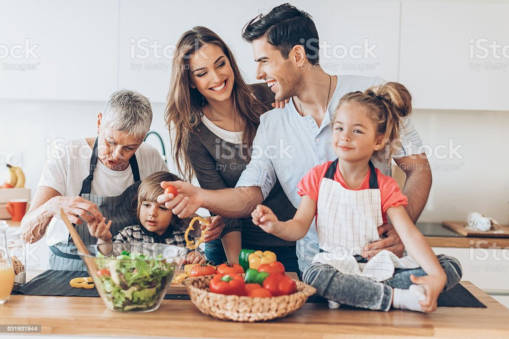 Happy multi-generation family in the kitchen stock photo