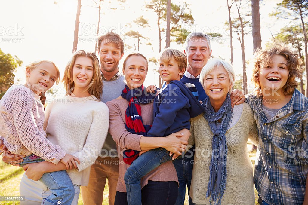 Happy multi-generation family portrait in the countryside stock photo