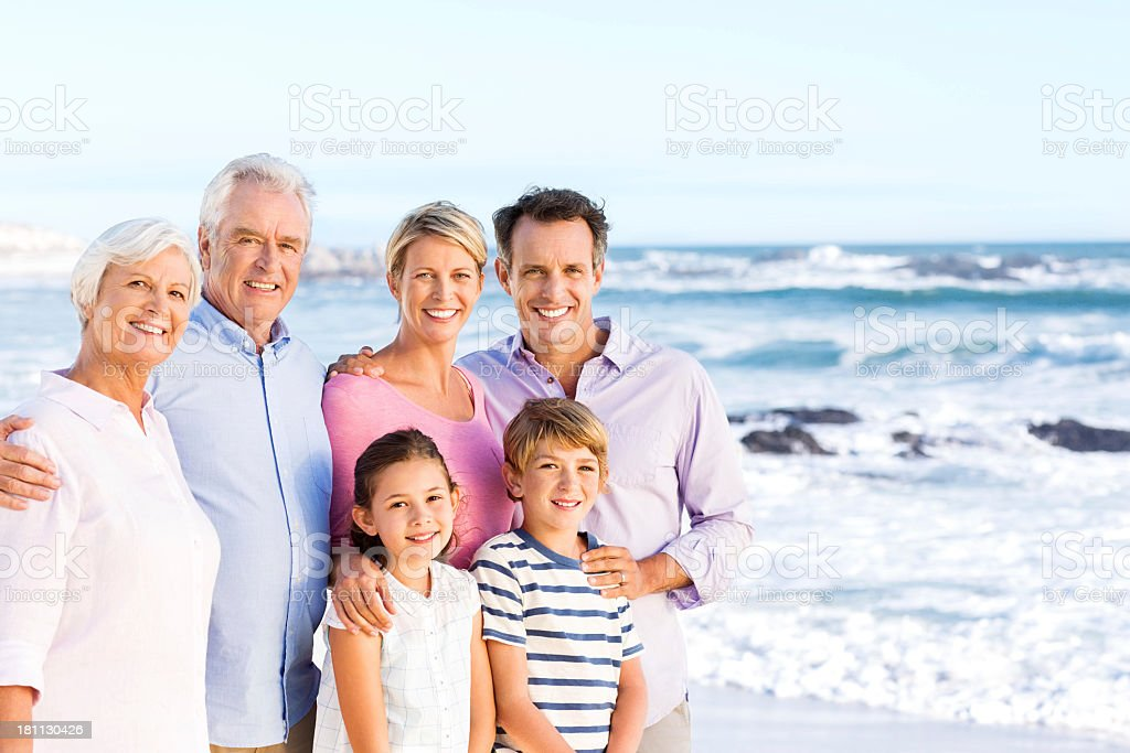 Happy Multi-Generation Family Standing By The Sea royalty-free stock photo