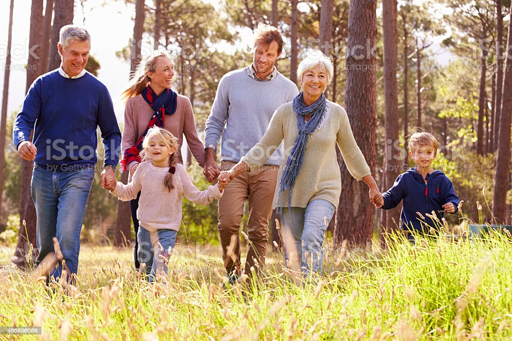 Happy multi-generation family walking in the countryside stock photo