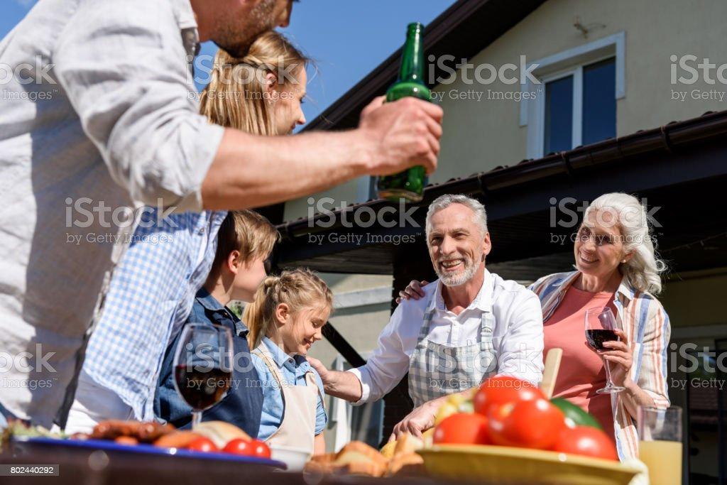 happy multi-generational family having picnic on patio at daytime stock photo