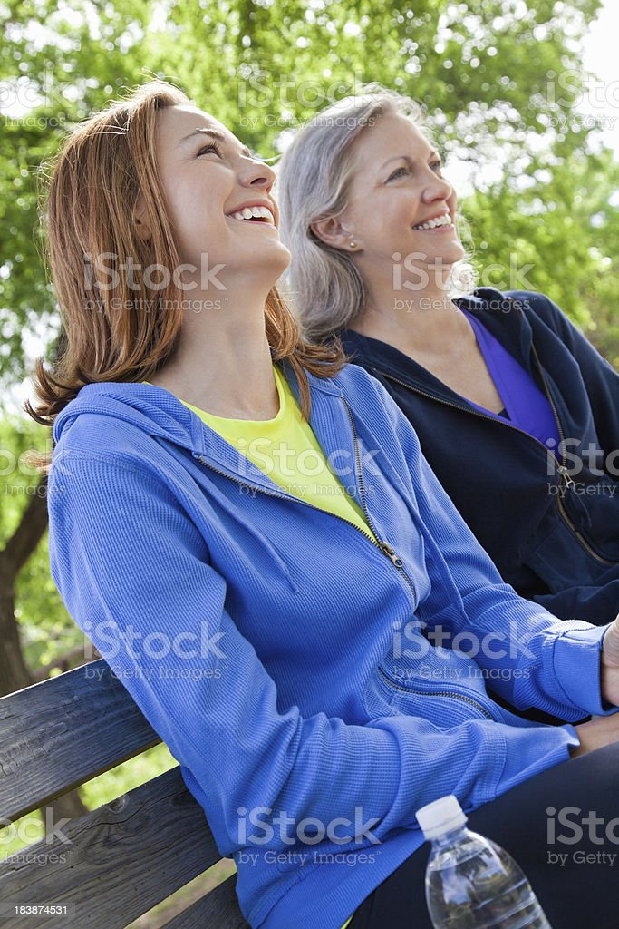Happy Multi-Generational Women Sitting at a park royalty-free stock photo