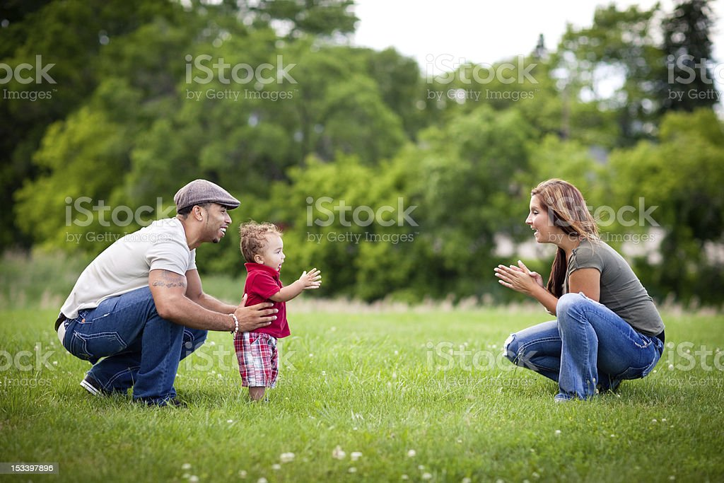Happy, Multiracial Family Playing Together Outside During Summer royalty-free stock photo
