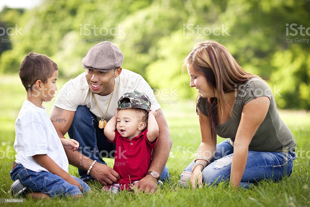 Happy, Multiracial Family Sitting Together Outside During Summer royalty-free stock photo