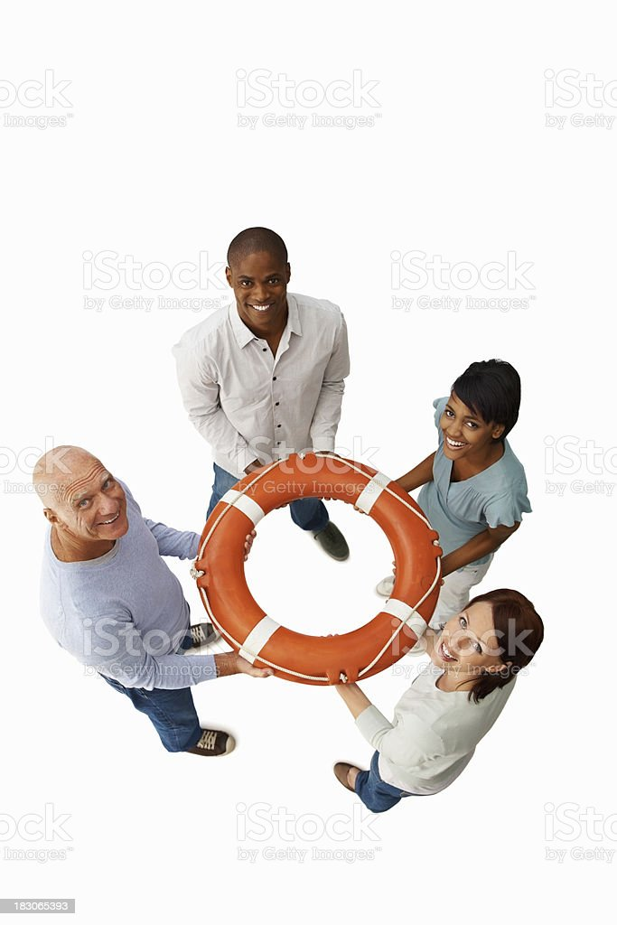 Happy multiracial people holding life buoy against white royalty-free stock photo