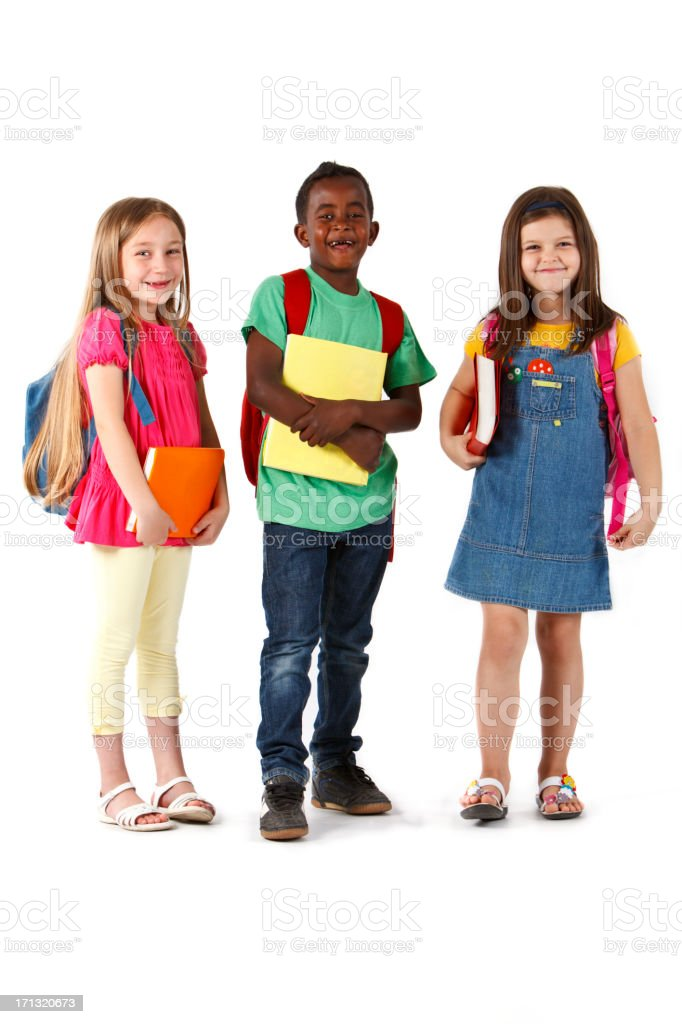 Happy multiracial school children standing with books and backpacks royalty-free stock photo