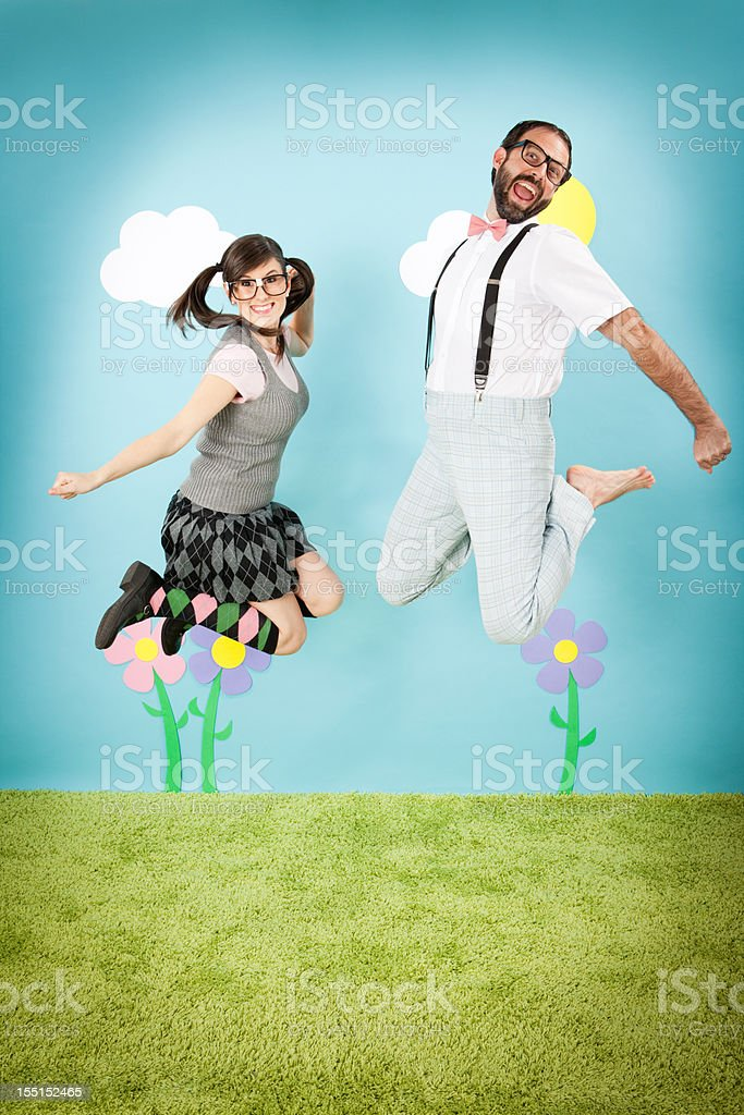 Happy Nerd Couple Jumping with Excitement, in Whimsical World royalty-free stock photo