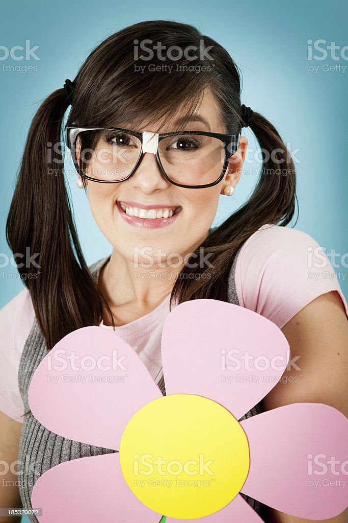 Happy Nerd Girl Holding Flower, in Whimsical, Outdoor World royalty-free stock photo