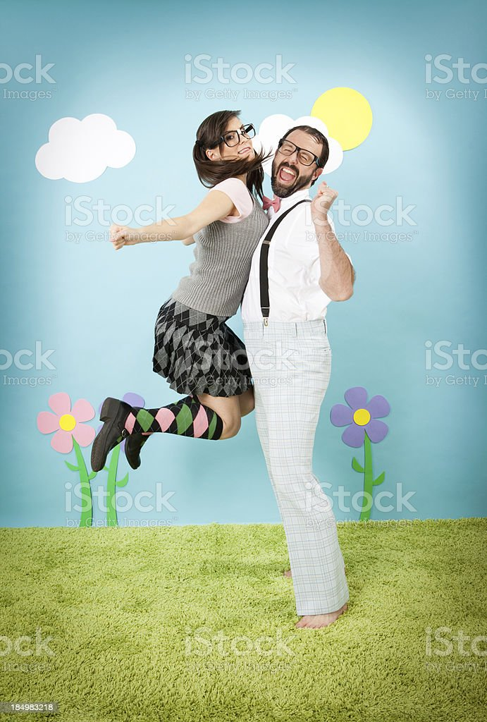 Happy Nerd Girl Jumping and Bumping Into Nerdy Guy royalty-free stock photo