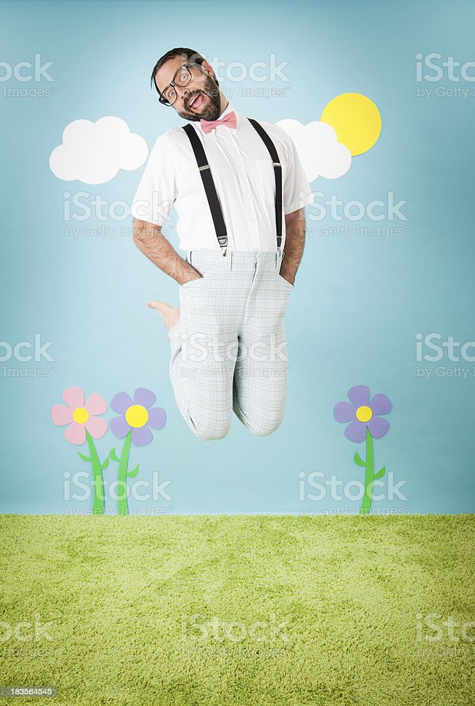Happy, Nerdy Man Jumping with Excitement Outside royalty-free stock photo