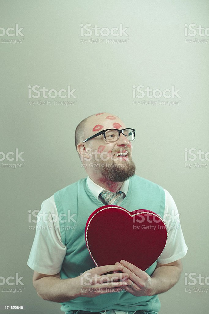 Happy Nerdy Man with Lipstick Kisses and Red Heart royalty-free stock photo