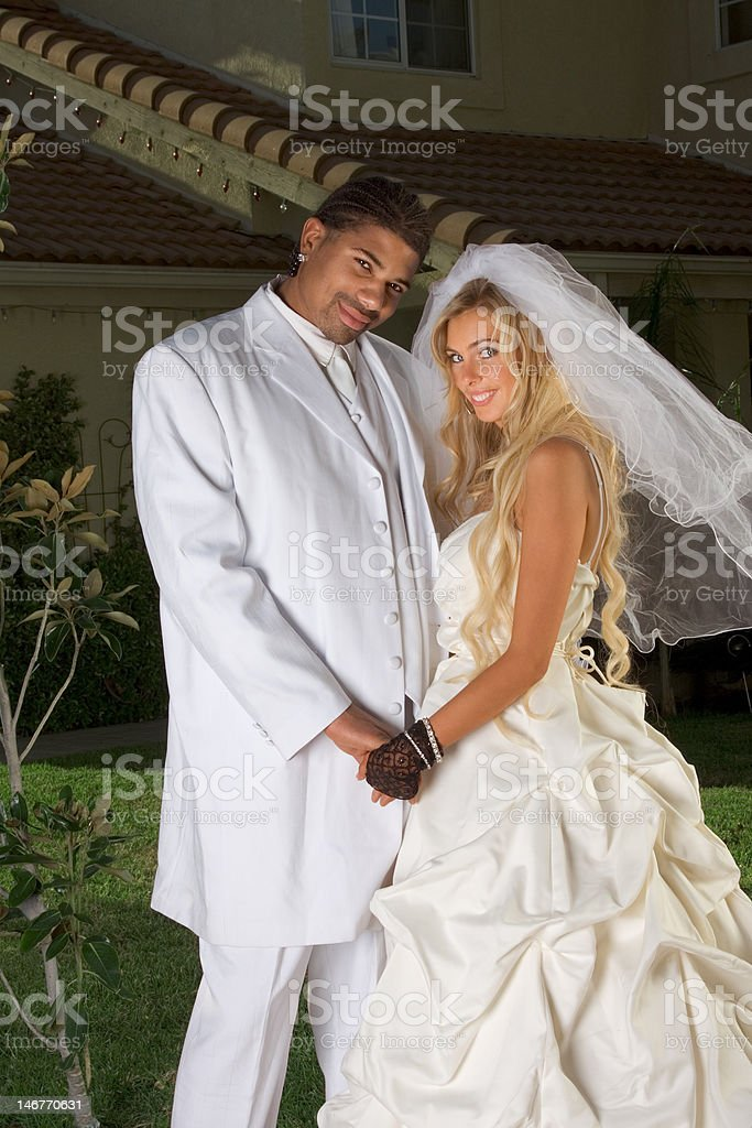 Happy new wed interracial couple in wedding mood royalty-free stock photo