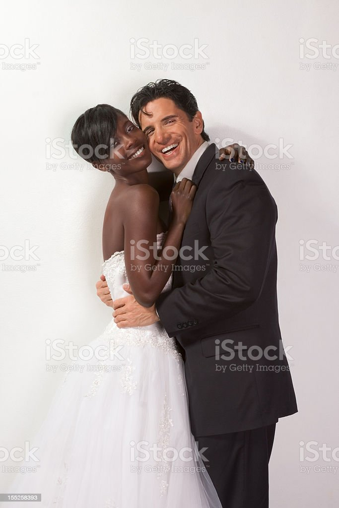 happy new wed interracial couple in wedding mood stock photo