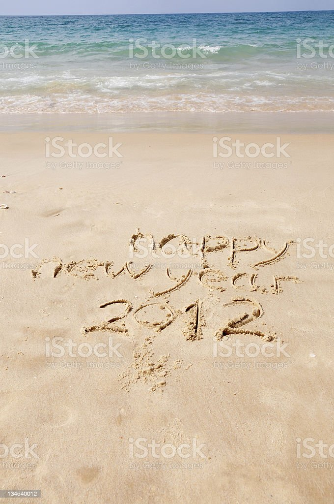 happy new year 2012 written in sand on beach royalty-free stock photo