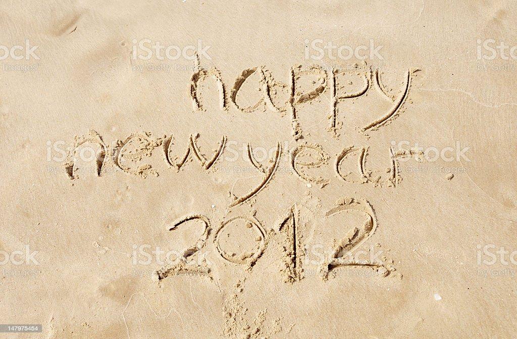 happy new year 2012 written in sand stock photo