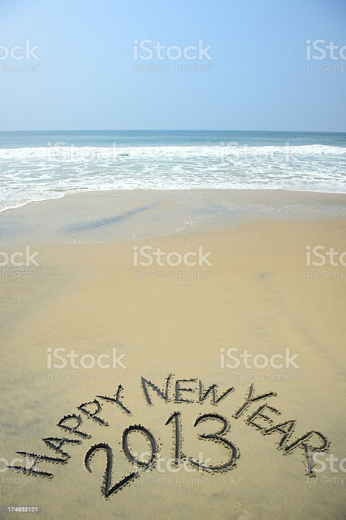 Happy New Year 2013 Message in Sand on Beach royalty-free stock photo