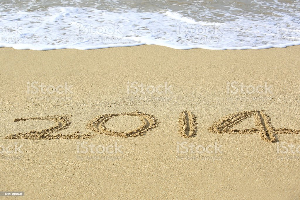 happy new year  2014 and sea wave on beach stock photo