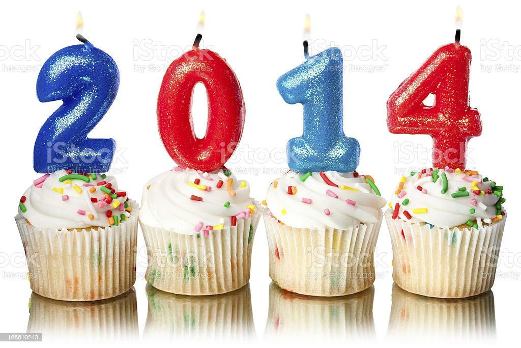 Happy New Year 2014 Candles and Cupcakes royalty-free stock photo