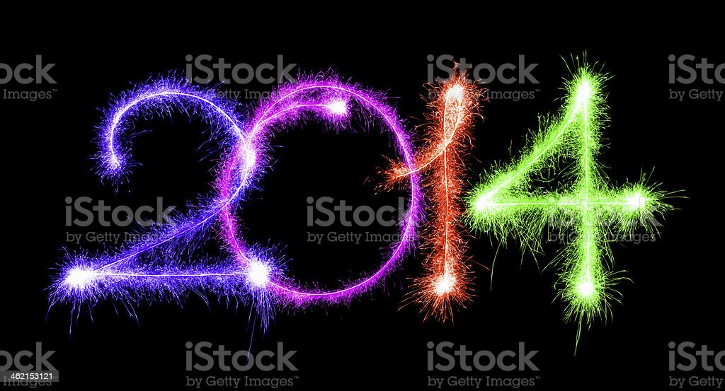 Happy New Year 2014 made a sparkler different colors stock photo