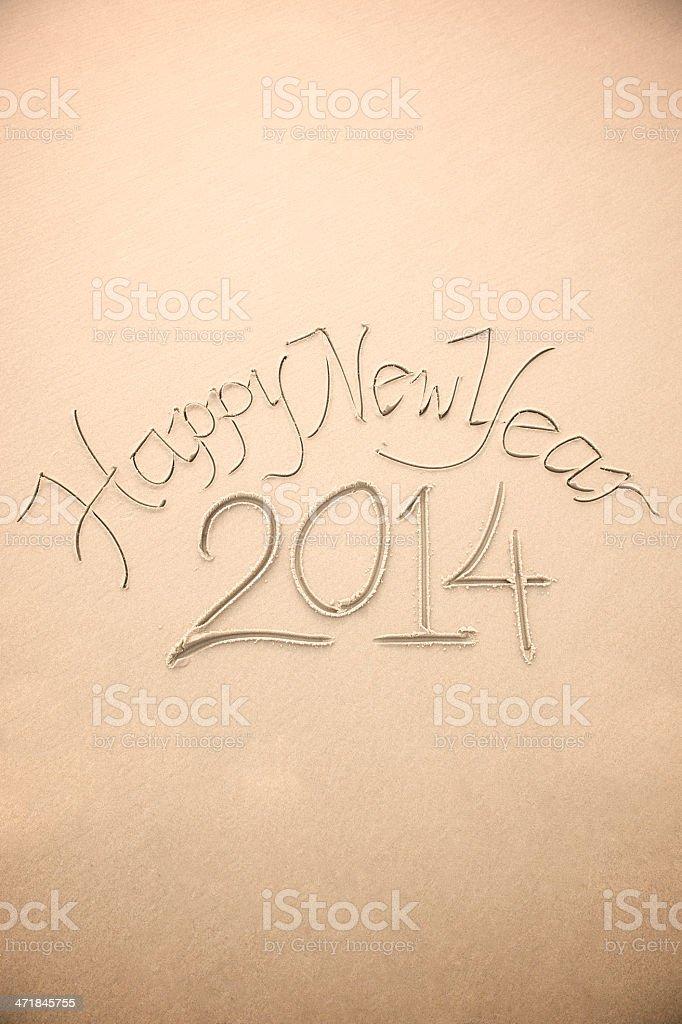 Happy New Year 2014 Message Handwritten on Sand Beach royalty-free stock photo